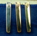 Modern Clip in Sterling Silver, Bronze, & Brass