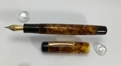Exemplar in Illuminated Amber Tortoise & Black Ebonite - Medium