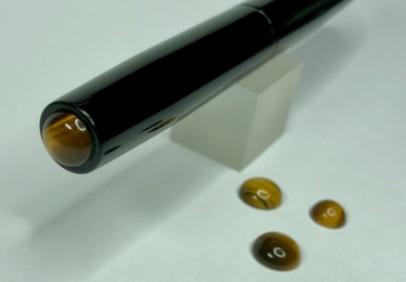 Illuminaire in Solid Black Ebonite with Tiger's Eye Cabochons - Small
