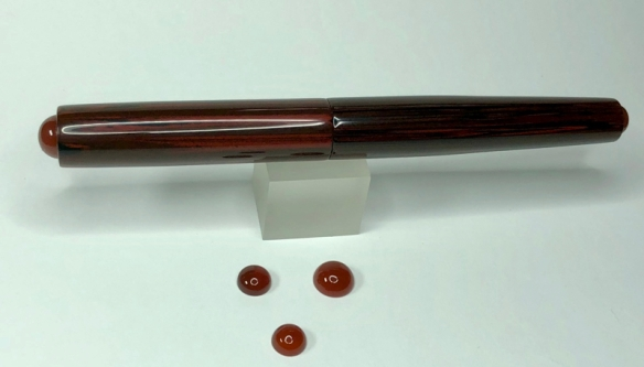 Illuminaire in NYH Cumberland Ebonite with Carnelian Cabochons - Small